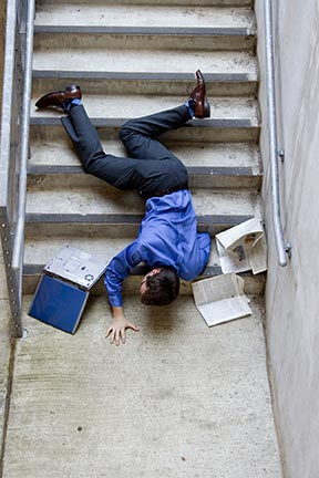 This picture is a simulation of what it may look like when a man falls down stairs. Slip and fall accidents, sometimes referred to as trip and falls, are covered by an area of law called premises liability. Contact a Shreveport premises liability attorney today to represent you in your slip & fall injury claim.